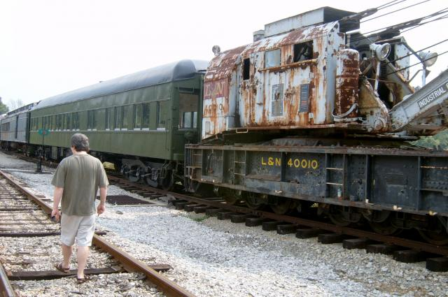 Rusting cars and back of bf